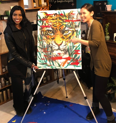 Katrina with the winner for the live painting raffle winner.